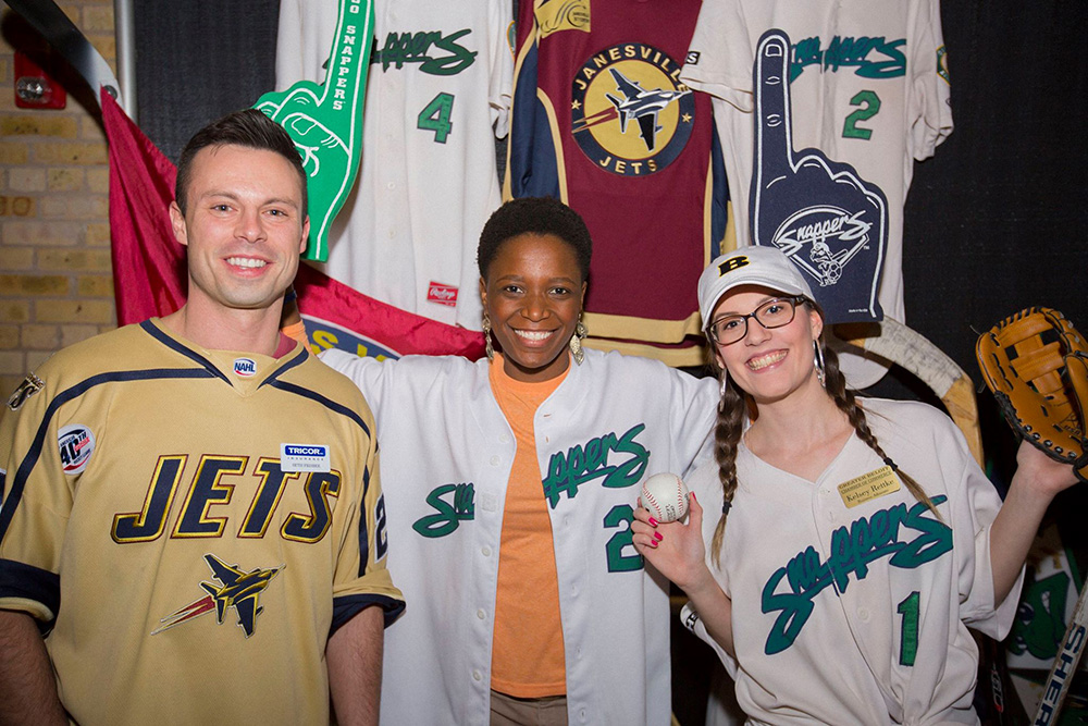 TRICOR employees wearing a variety of hockey jerseys at the Grapes & Hops fundraiser for KANDU Industries