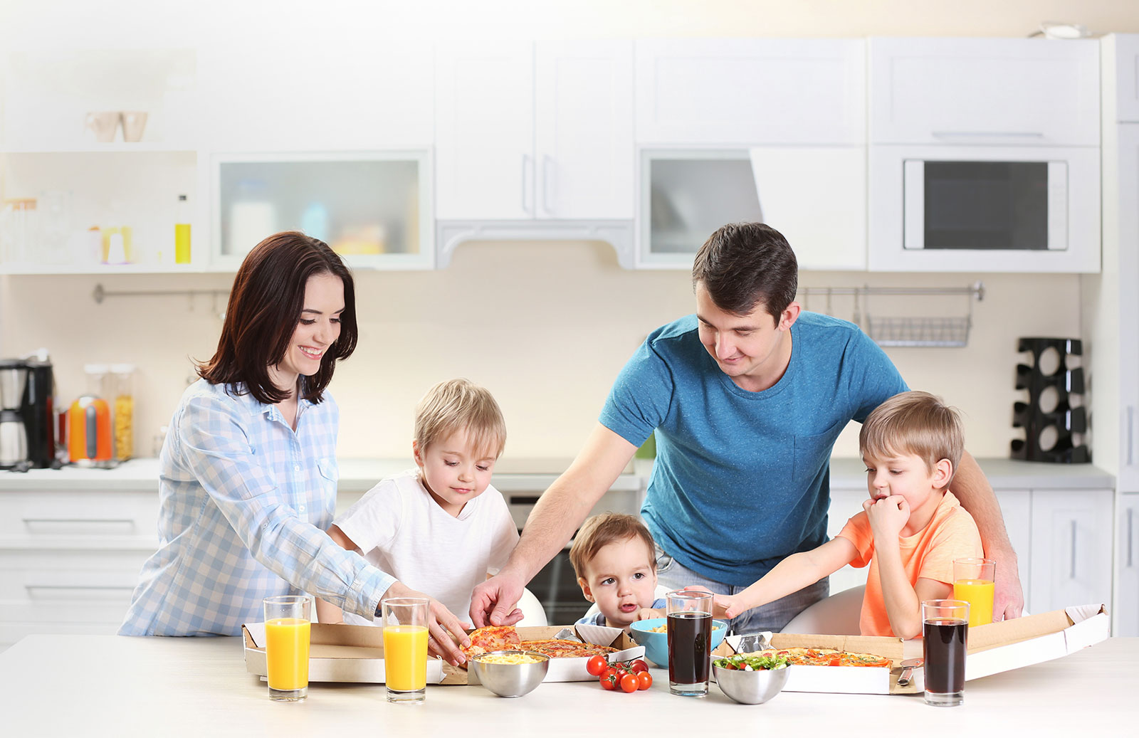 Family sitting around the kitchen table; TRICOR home insurance